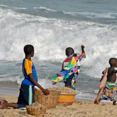 Ghana kids on the beach collecting shells.jpg