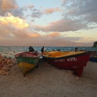 Jamaica Beach with Boats at Sunset.jpg